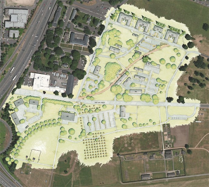Artist's representation of the proposed site plan for Vancouver Barracks, superimposed on an aerial photo.