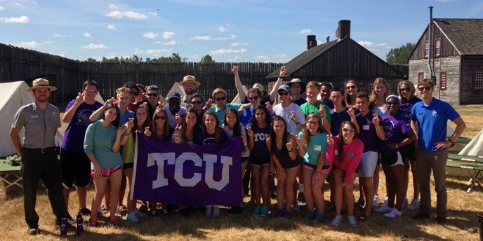 A volunteer group from TCU and park staff pose after a volunteer project.