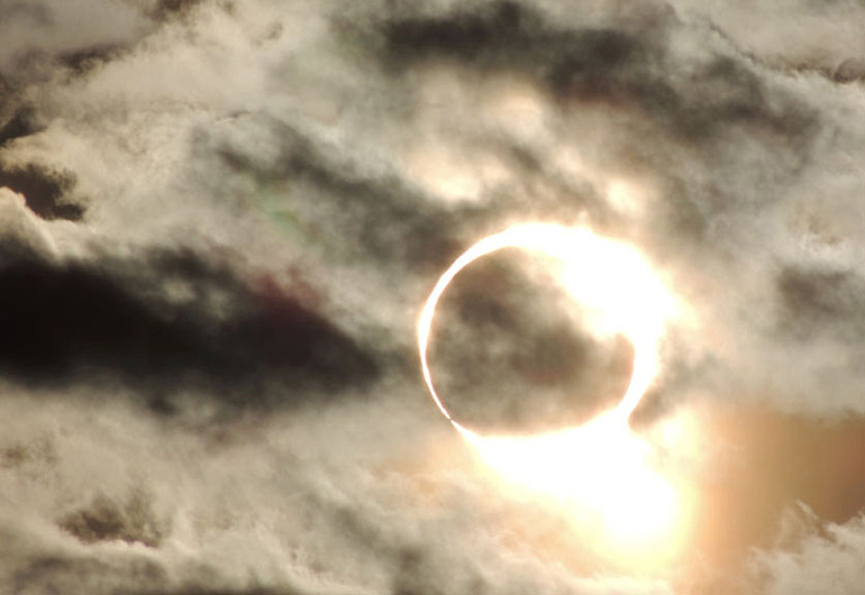 Photo of solar eclipse with ring of sunlight around moon