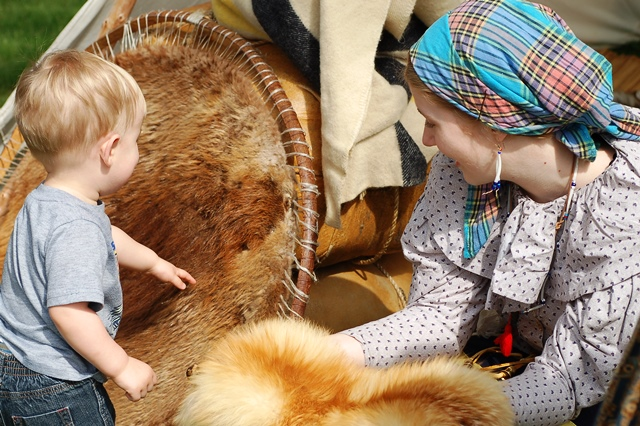 A young visitor learns about beaver fur.