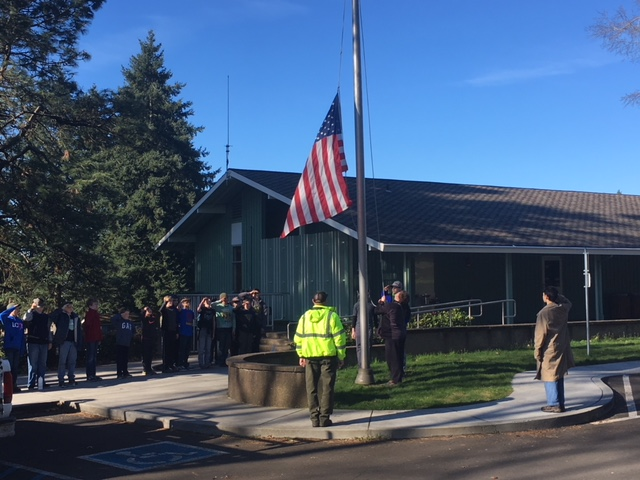 Photo of boy scouts raising an American flag at the Fort Vancouver Visitor Center.