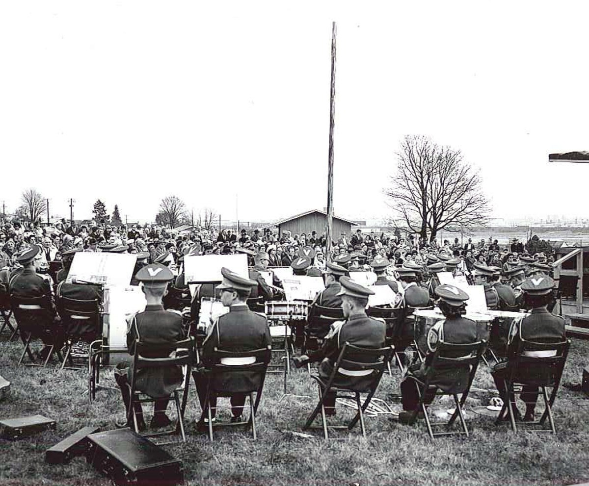 View of a band set up to play in front of a crowd at the dedication of the park's Visitor Center, 18 March 1962.