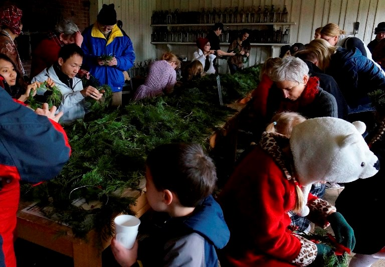 Visitors make wreaths and enjoy hot cider in the Bakehouse - Credit Joe Blanco