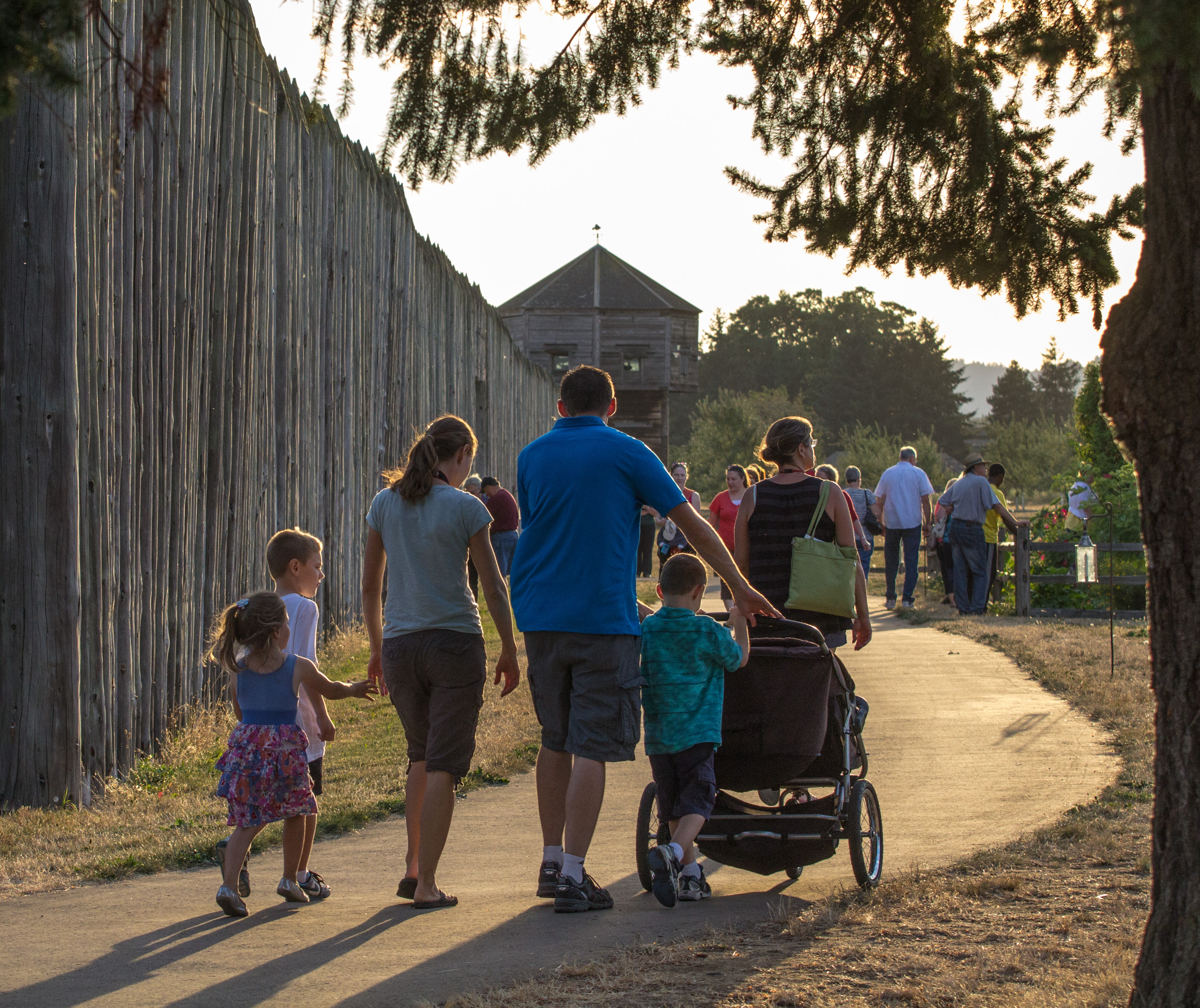 Visitors walk towards the fort during Campfires & Candlelight