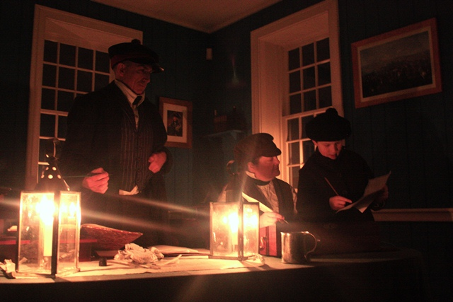 Volunteers portray clerks at the Fort Vancouver Counting House
