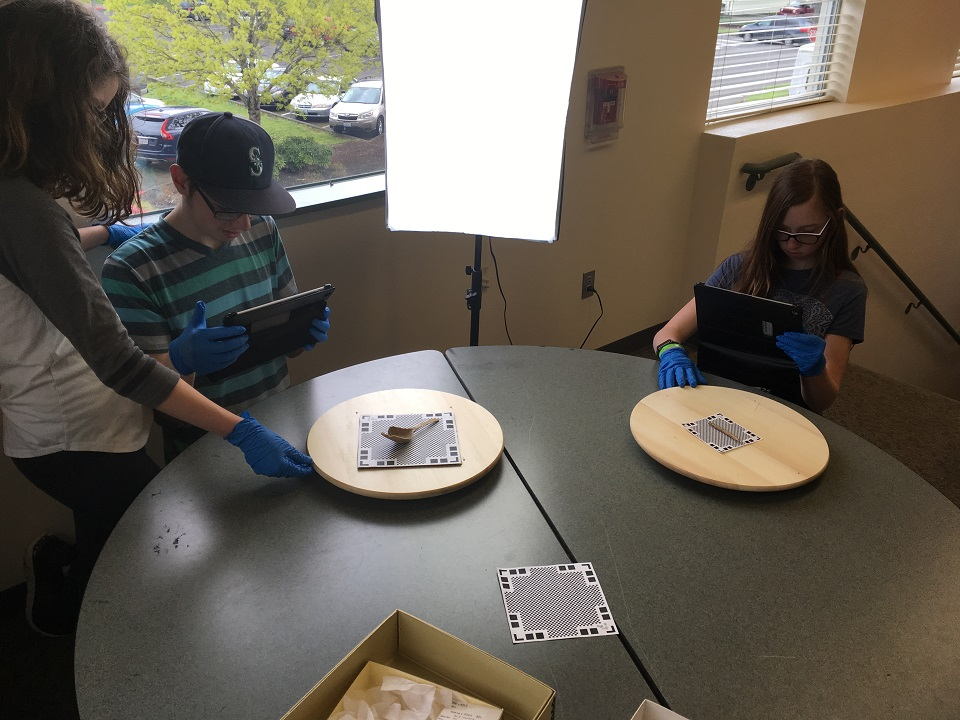 Photo of students working with artifacts.