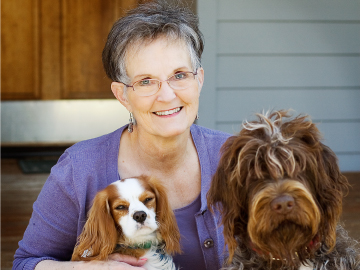 Photograph of Jane Kirkpatrick and two dogs