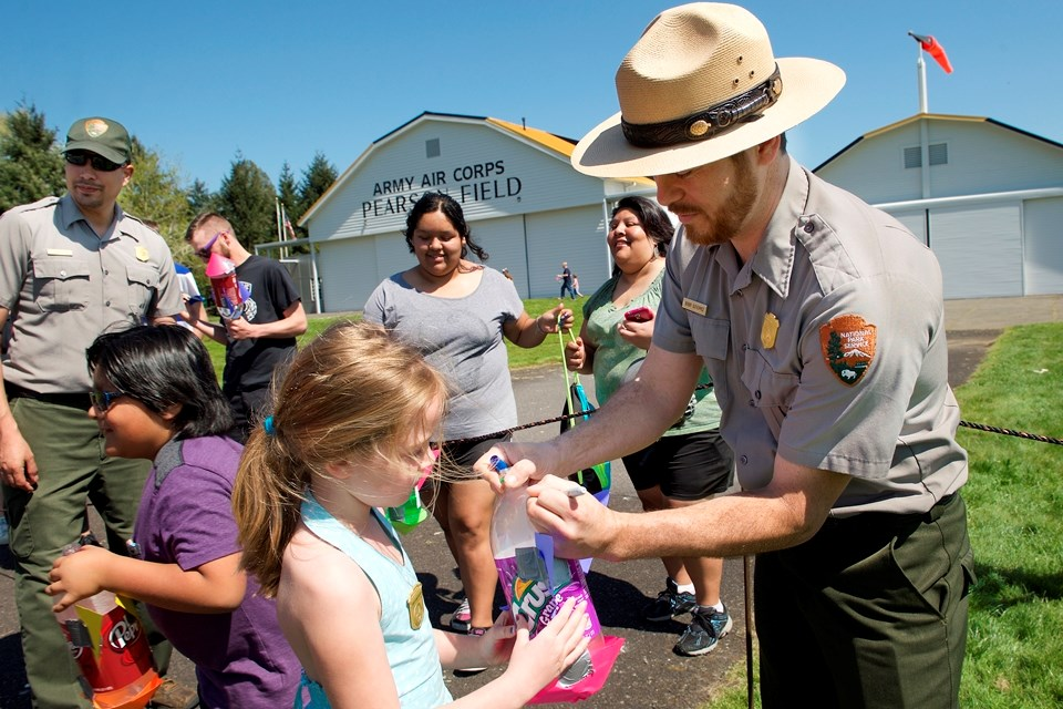 National Park Ranger helping kids with activites at Yuri's Night