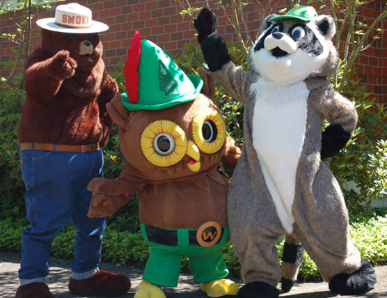 Smokey Bear and Woodsy Owl mascots from partner organizations welcome visitors to National Get Outdoors Day in 2011