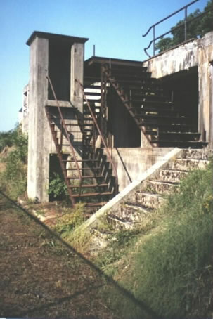 Phone booth and stairs leading to loading platform (Photo by Roy V. Ashley)
