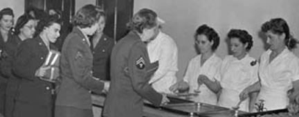 Photo of the WACs in line for dinner