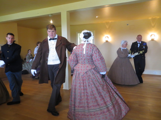 Men and Women in Victorian Dress Dancing