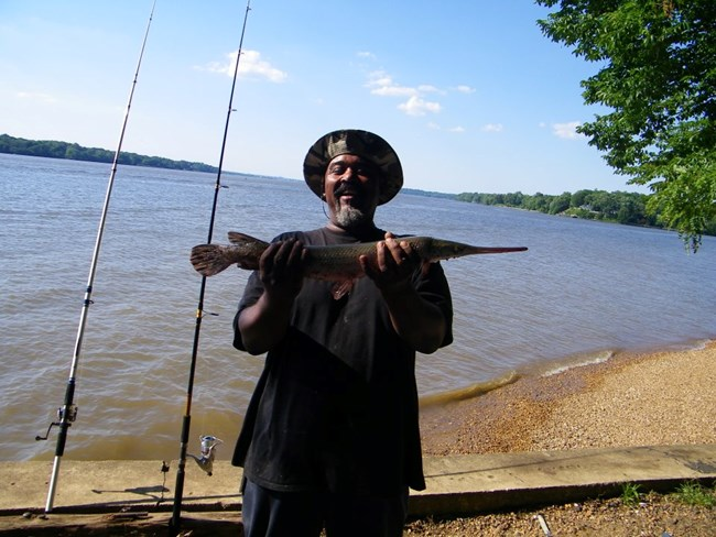A Fort Washington fisherman with a healthy Longnose Gar.