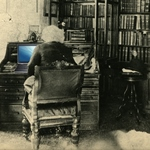 A graphic of Frederick Douglass working on a computer at his desk