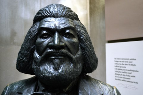 A close-up of a statue of Frederick Douglass focusing on his face