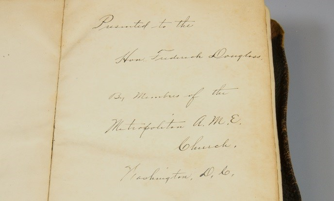 "The cursive, handwritten, ink inscription inside the Bible reads ""Presented to the Hon. Frederick Douglass by members of the Metropolitan A.M.E. Church, Washington, D.C."""