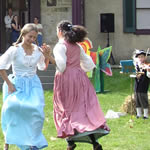 Children in historic clothing dancing on the Gallatin House lawn