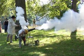 Re-enactors Firing cannon