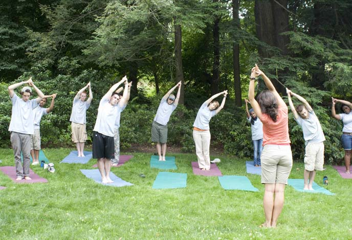Adrienne Sharigian leading a yoga class on Fairsted's South Lawn.