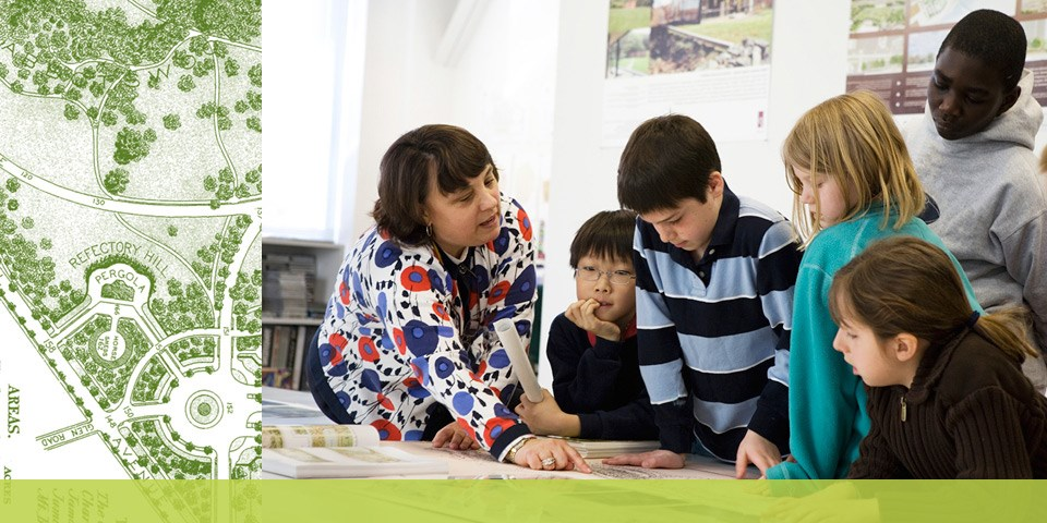 Landscape Architect shows a plan to students visiting her office