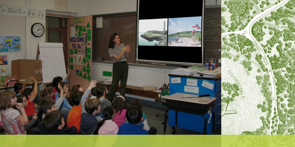 Park Ranger showing students a slide show as part of a Good Neighbors pre-vist
