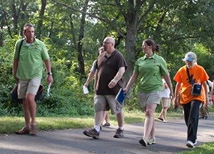Institute participants walking on a path in Franklin Park