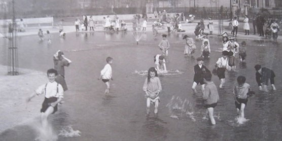 A c. 1910 photo of children playing in Washington Park in Chicago