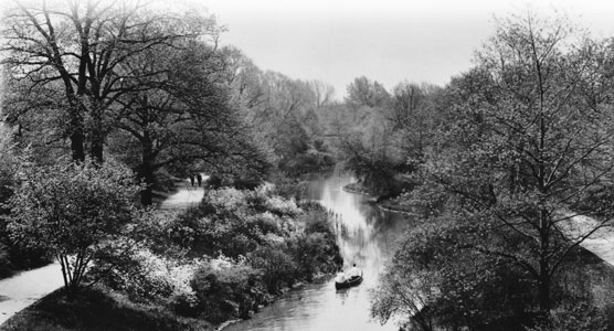 A 1920 photo of a two people canoeing up the Muddy River. See caption further down the page.