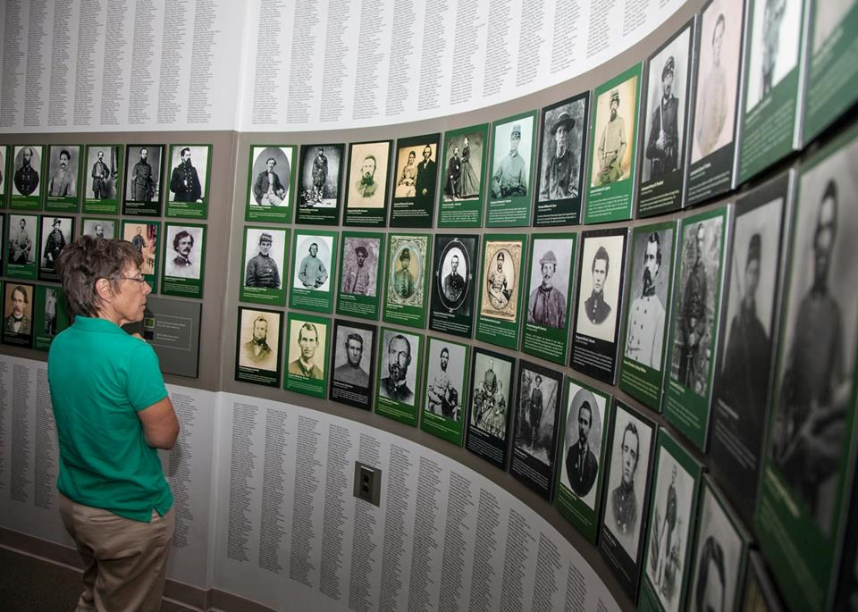 Visitor contemplates Wall of Faces exhibit at Chancellorsville Visitor Center