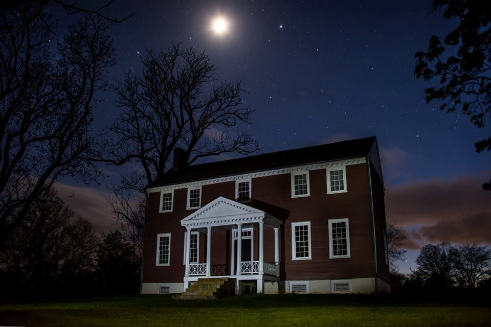 Ellwood Manor at night with the moon and stars