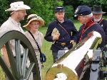 Visitors mingling cannon crew