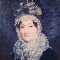 Portrait of Hannah Coalter from shoulders up, wearing dark dress and bonnet