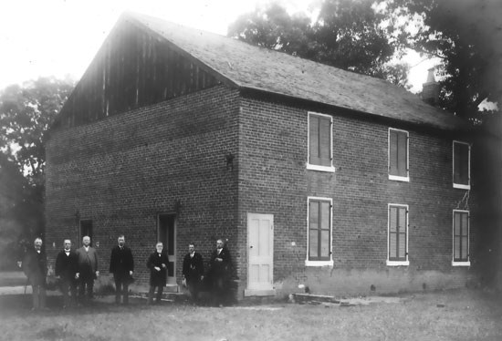 Civil War Veterans standing next to Salem Church