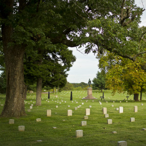 Fredericksburg National Cemetery, graves spread out in front, with A. A. Humphreys statue standing near the center
