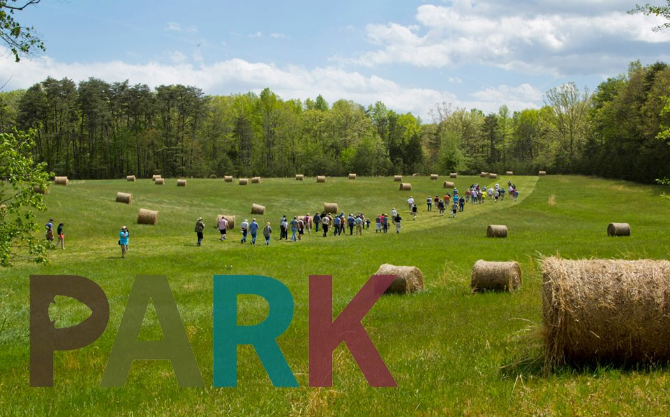 """Park"" logo on photo of field with hikers and hay bales"