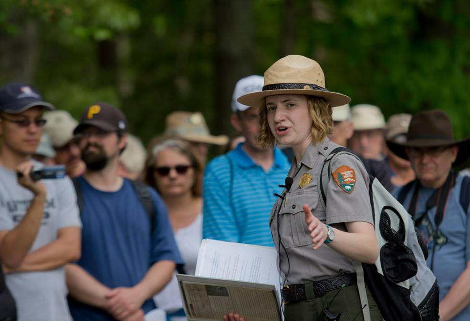 Park historian conducts tour of Spotsylvania Court House battlefield with visitors in background