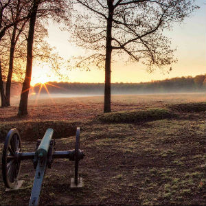 Sunrise in Saunders Field with cannon and earthworks