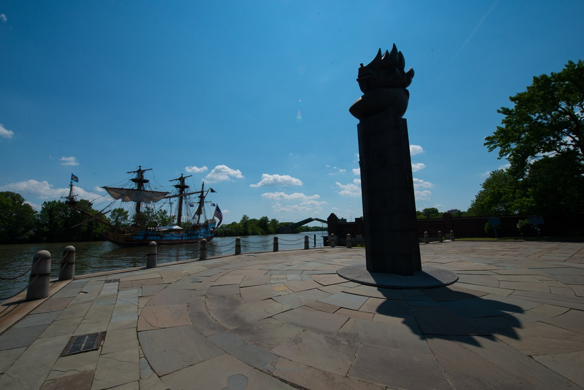 The Kalmar Nyckel, Delaware's Tall Ship, sails past the monument at Fort Christina.
