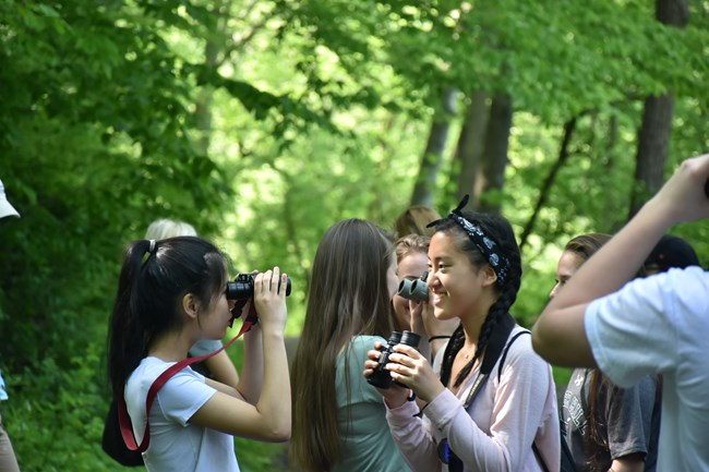 Students practice with their binoculars, and get ready for the bird inventory walk.