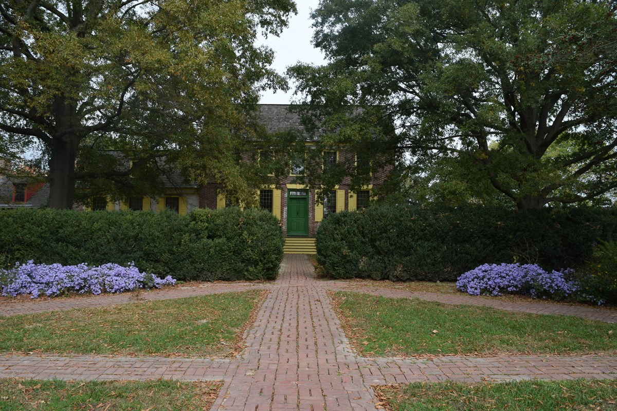 Three paths with surrounding flowers in front of Poplar Hall at the John Dickinson Plantation.