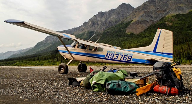 A bushplane on a gravel bar along the North Fork of the Koyukuk River, below Frigid Crags