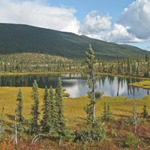 A lake in the boreal forest & mountains