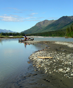 Loading the inflatable boat on the North Fork of the Koyukuk River.
