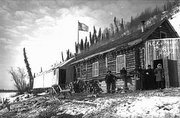 Historic photo of the riverfront store and saloon at Bergman, Alaska in the winter of 1899.