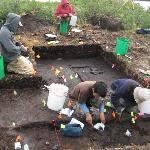 Archaeologists excavating at Matcharak Lake