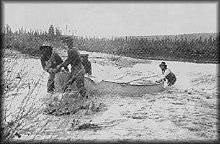 Pulling canoe up Kobuk River