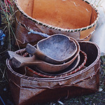 A collection of handmade birch bark baskets and hand carved wooden ladles.