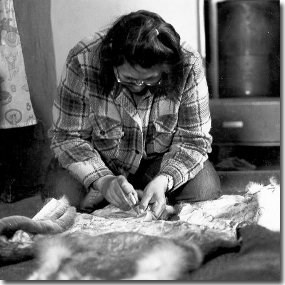 Nunamiut woman working with caribou hide (Anchorage Museum of History and Art, Ward W. Wells Collection, WWS-5122B)