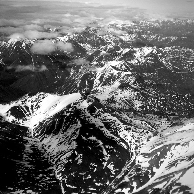 Aerial photo of the Brooks Range with snow in black and white