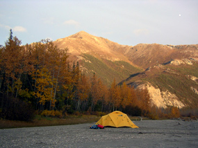 Tent on gravel bar.
